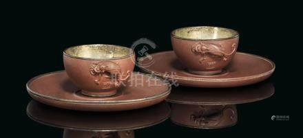 A PAIR OF YIXING SILVER-LINED CUPS AND SAUCERS