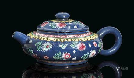 A VERY RARE YIXING COMPRESSED FAMILLE ROSE BLUE-GROUND TEAPOT AND COVER