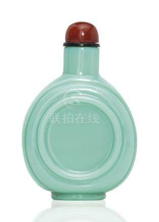 A CARVED TURQUOISE GLASS SNUFF BOTTLE