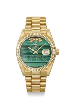 Rolex. A very fine and rare 18K gold automatic wristwatch with sweep centre seconds, date, day, malachite dial, bracelet, brochure, display clip and box