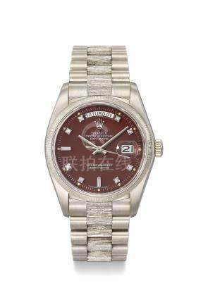 ROLEX. A VERY FINE, RARE AND ATTRACTIVE 18K WHITE GOLD AUTOMATIC WRISTWATCH WITH SWEEP CENTRE SECONDS, DAY, DATE, BURGUNDY RED LACQUER AND DIAMOND-SET STELLA DIAL, BRACELET, INTERNATIONAL GUARANTEE AND BOX