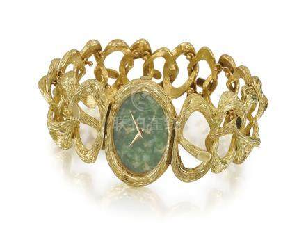 PIAGET. A VERY FINE AND ELEGANT LADY'S 18K GOLD BRACELET WATCH WITH JADE DIAL