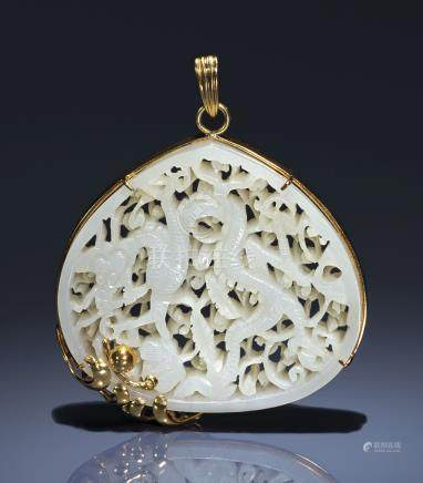 A WHITE JADE RETICULATED 'DRAGON' PLAQUE