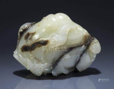 A WHITE AND BLACK JADE 'BATS AND PEACH' CARVING