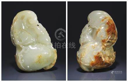 A WHITE AND RUSSET JADE 'BAT AND GOURD' CARVING