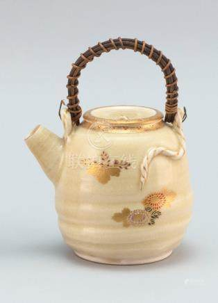 JAPANESE SATSUMA POTTERY TEAPOT In ovoid form. With paulowni