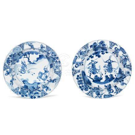 A matched pair of blue and white 'Romance of the Three Kingdoms' dishes Kangxi six-character marks and of the period (2)