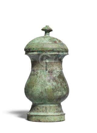 An archaic bronze wine vessel and cover, zhi Shang Dynasty (3)