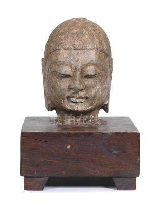A carved stone head of Buddha  6th century or later (2)
