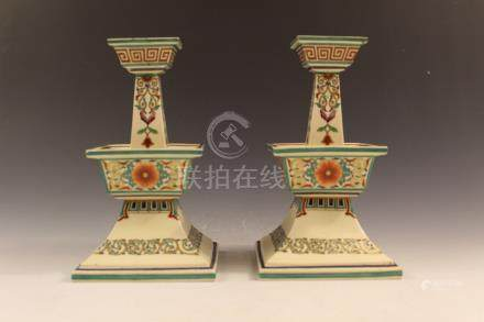 A pair of porcelain candle holders