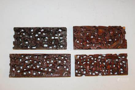 Set of four Chinese carved wood panels.