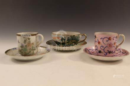 Three sets of Japanese porcelain cups and saucers.