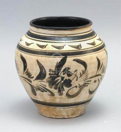 CHINESE CIZHOU POTTERY JAR In ovoid form. With stylized flor