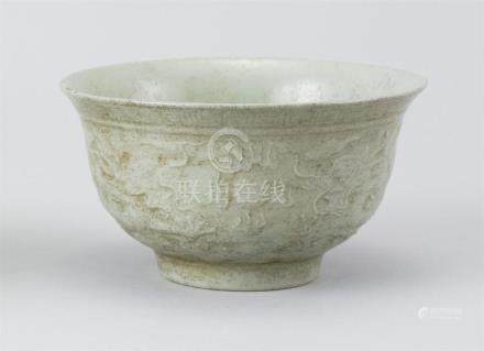 CHINESE CARVED CELADON BOWL In bell form. With five-claw dra
