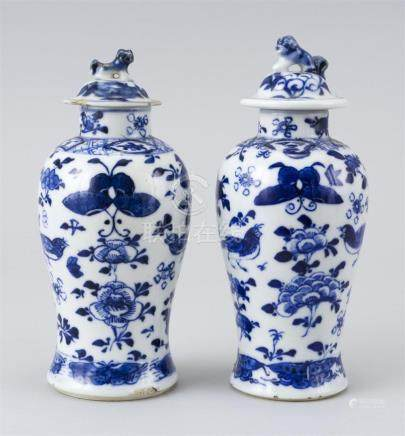 PAIR OF CHINESE BLUE AND WHITE PORCELAIN COVERED JARS With b