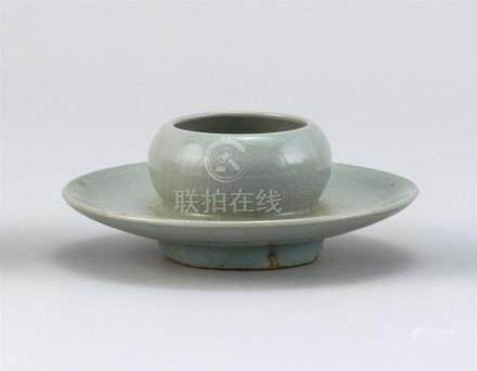 CHINESE CELADON STONEWARE FOOTED CUP In ovoid form with sauc