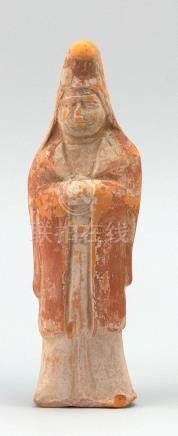 CHINESE POTTERY TOMB FIGURE Depicting a standing official we