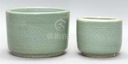 TWO CHINESE CELADON CENSERS Both in cylinder form with carve