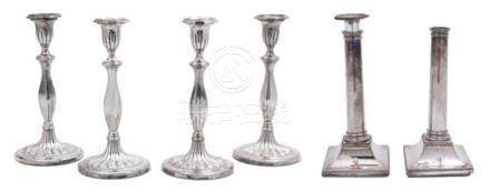 A Pair of Sheffield Plate Columnar Candlesticks and a Set of