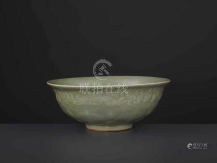 A CARVED LONQUAN LOTUS BOWL, MINGChina, 16th/17th century. Covered overall (except the foot rim)