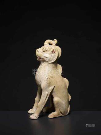 A GLAZED CERAMIC UNICORN, TANG China, 618-907. The pottery statue neatly modelled with the unicorn