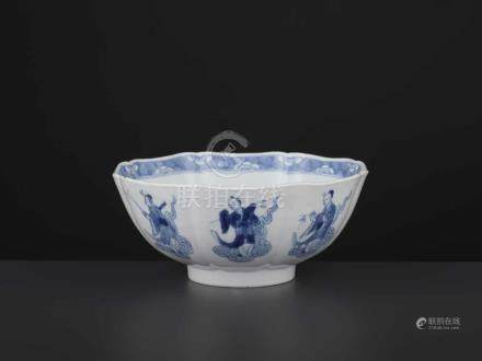 A KANGXI IMMORTALS BOWLChina, 1662-1722. The eight-lobed vessel neatly painted in cobalt blue