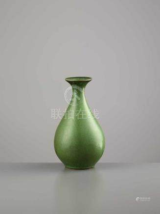 A YUHUCHUN PING, 18TH CENTURYChina, 1700-1800. The pear-shaped vase is covered by an elegant,