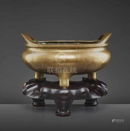 A VERY LARGE BRONZE CENSER, QIANLONGChina, 18th century. The compressed globular body raised on