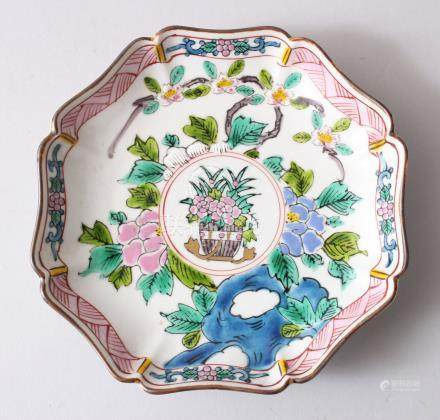 A 19TH CENTURY CHINESE FAMILLE ROSE SAUCER DISH, painted decoration to depict floral scenes , the