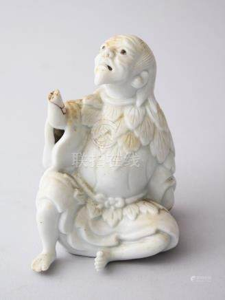 A 20TH CENTURY CHINESE BLANC DE CHINE PORCELAIN FIGURE OF LUOHAN, 9cm high.