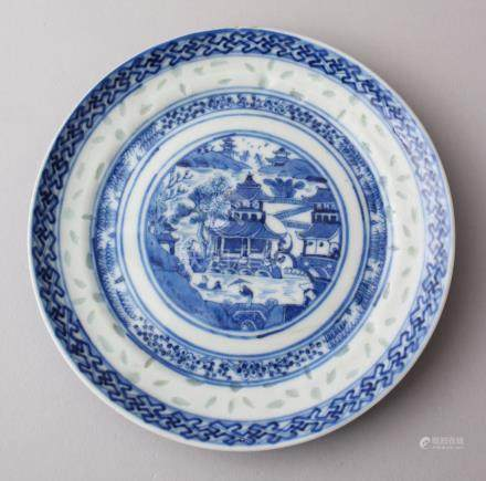 A 19TH CENTURY CHINESE BLUE & WHITE PORCELAIN plate, decorated with celadon fleck, with the