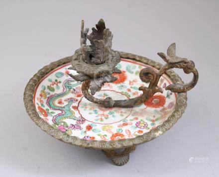 A 19TH CENTURY CHINESE FAMILLE ROSE PORCELAIN SAUCER WITH ADDED FRENCH GILT METAL MOUNTINGS, the