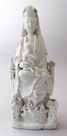 A 18TH / 19TH CENTURY CHINESE BLANC DE CHINE FIGURE OF GUANYIN WITH THREE BOYS, 38.5cm high X 14.5cm