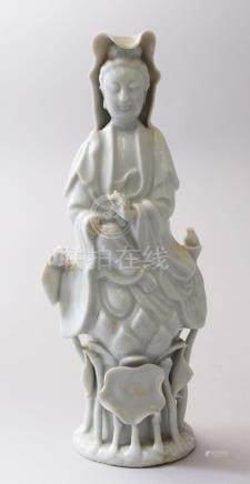 A SMALLER 19TH CENTURY CHINESE BLANC DE CHINE PORCELAIN FIGURE OF GUANYIN, stood upon a lotus