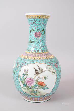A CHINESE FAMILLE ROSE BOTTLE SHAPED VASE, the main body decorated upon a turquoise ground with