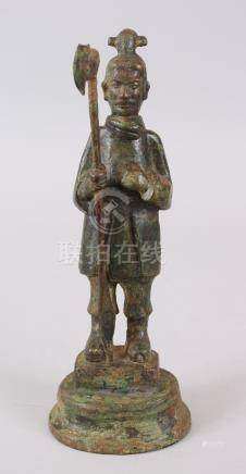 A GOOD CHINESE HAN DYNASTY BRONZE FIGURE OF A SOLDIER, stood holding his halberd, the base with a