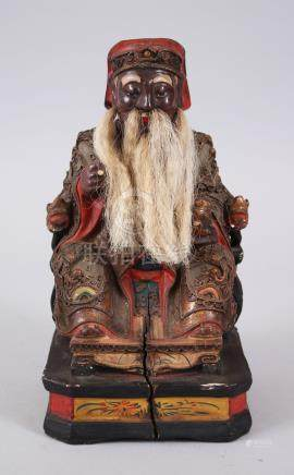 A GOOD 19TH CENTURY CHINESE WOOD & LACQUER SEATED SAGE FIGURE, seated upon his throne, wearing