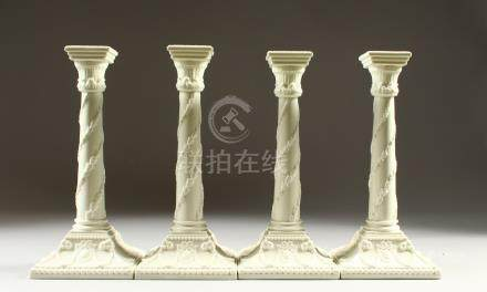 A SET OF FOUR WORCESTER STYLE BLANC DE CHINE GLAZED CANDLESTICKS, of classical design. 27cms high.
