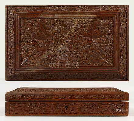 A FINELY CARVED INDIAN SANDALWOOD BOX with velvet interior. 28cms long x 17cms wide.