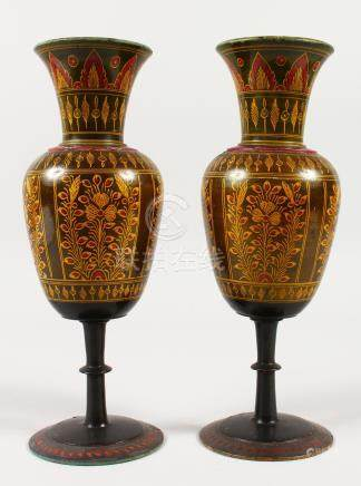 A PAIR OF HOSHIAPUR SANDALWOOD VASES, turned wood and painted. Retail label on base. 26cms high.