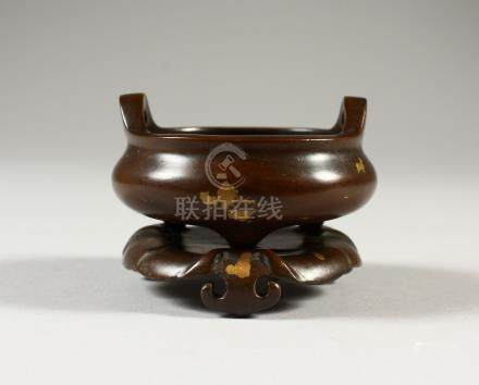 A SMALL CHINESE GOLD SPLASH CIRCULAR CENSER ON STAND. 605cms wide.