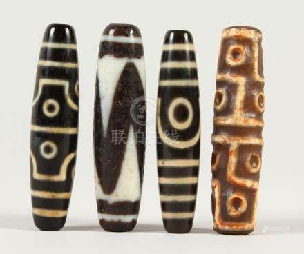 FOUR TIBETAN AGATE BEADS. Each 6cms wide.