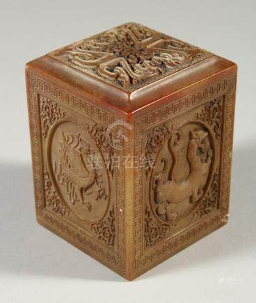 A CHINESE SQUARE CARVED SOAPSTONE SEAL. 8cms high.