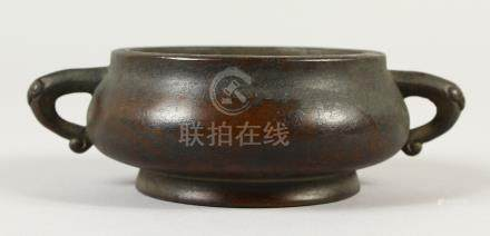 A CHINESE CIRCULAR BRONZE TWIN HANDLE CENSER, with nine character marks to the base. 14cms wide.