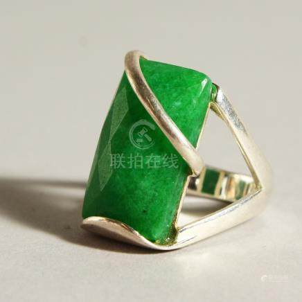 A SILVER AND JADE RING.