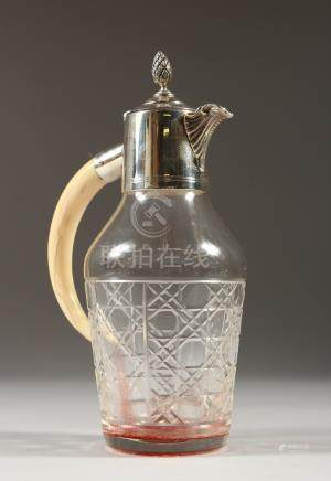 A SMALL OIL BOTTLE with tusk handle.
