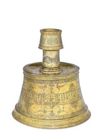 A SILVER AND COPPER-INLAID BRASS CANDLESTICK