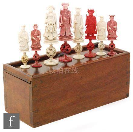 An Anglo-Chinese carved ivory chess set, circa 1900, the thirty eight piece set,