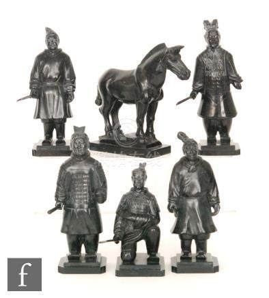 A collection of black polished hardstone terracotta army style figures,