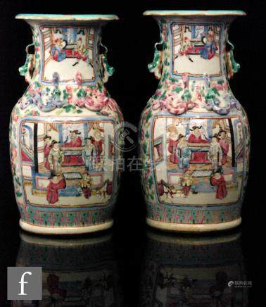 A pair of late 19th Century Chinese Canton famille rose vases,